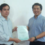 Course participant receiving CF certficate from Prof Monchai at conclusion of course.
