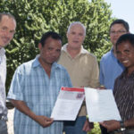 Visiting East Timorese scientists Joaquim Cabral and Abel Ximenes receiving training certificates from Drs Darryl Hardie and Vincent Lanoiselet (Department of Agriculture and Food) and Dr Aaron Maxwell (Commonwealth Department of Agriculture Fisheries and Forestry)