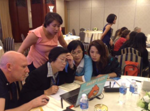 Participants reviewing case materials which include digitised  fish histology slides